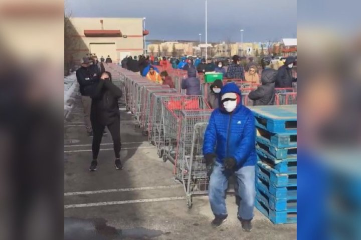 Coronavirus: Calgary doctor leads workout as people wait in line at Costco