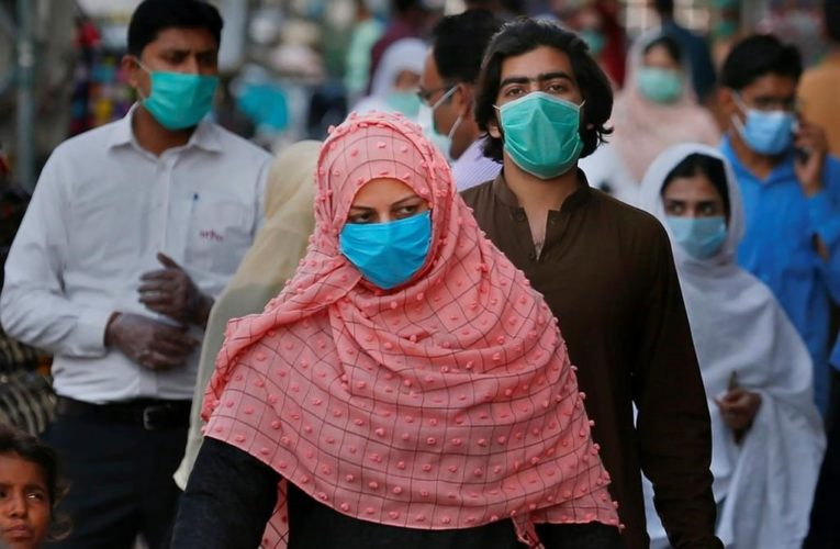 WHO recommends wearing masks in public, in updated guidelines