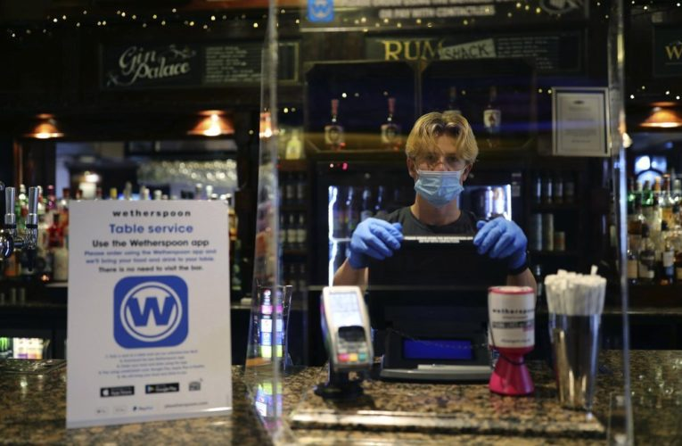 Coronavirus: Pubs, hairdressers reopen in England amid COVID-19