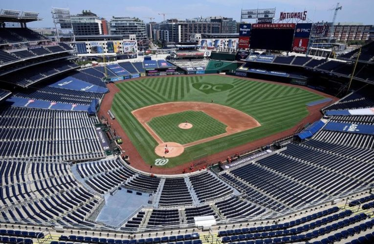 Face masks, empty parks: MLB season opens with coronavirus front of mind