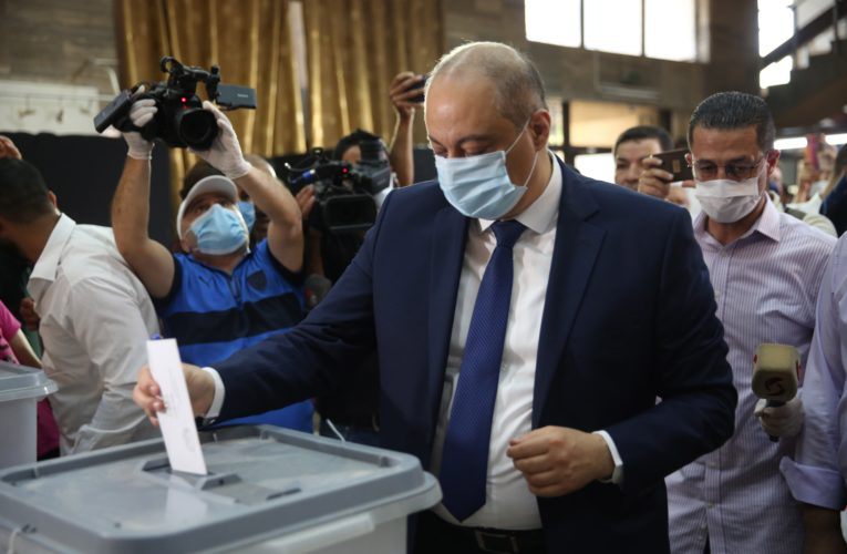 Syrians cast ballots in parliamentary election amid strict coronavirus protocols
