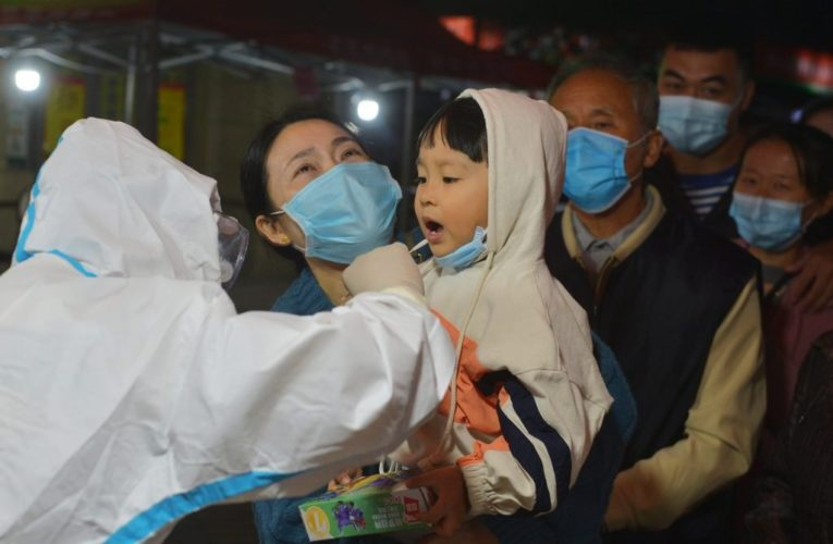 China fires 2 health officials after new coronavirus outbreak in northern city