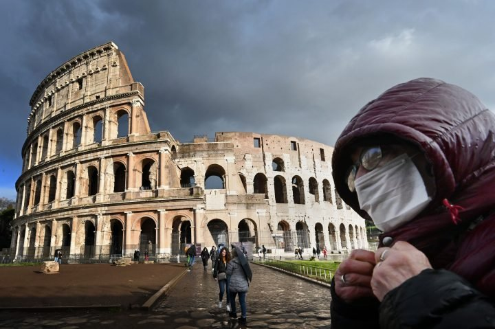 Italy makes face masks mandatory outdoors as coronavirus cases climb