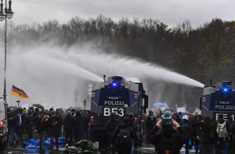 Police fire water cannons at demonstrators protesting coronavirus restrictions in Berlin