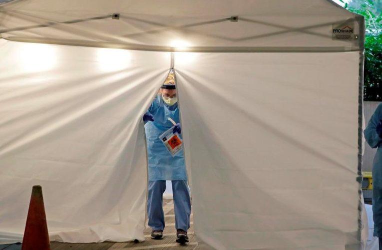 U.S. coronavirus vaccine plans take shape as hospitalizations set new records