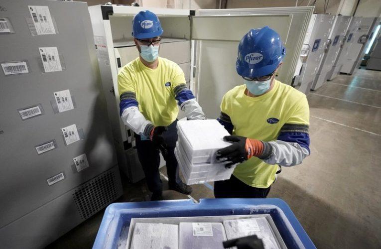 U.S. coronavirus deaths top 300,000 as mass vaccination effort begins