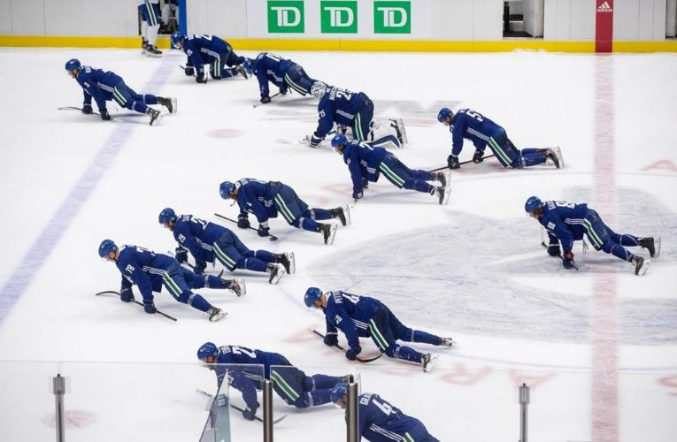 Canucks pause training camp after 'potential exposure of COVID-19'