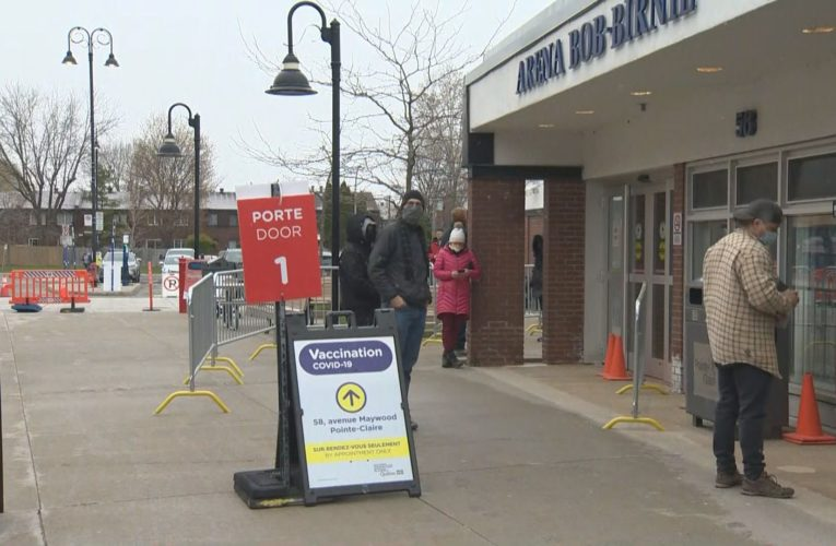 Montrealers line up bright and early for AstraZeneca vaccine after province expands access