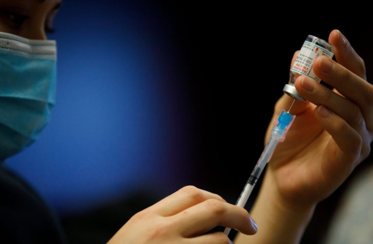 50% of U.S. adults have received both COVID-19 vaccine doses, CDC says