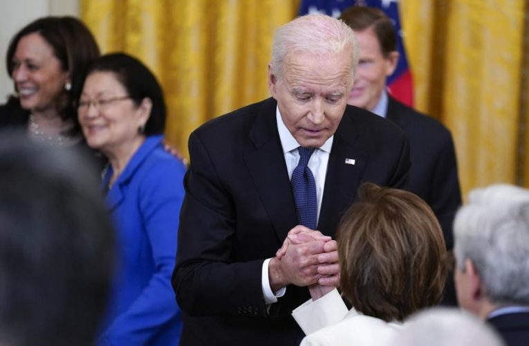 Face masks mostly out, hugs in at White House as U.S. COVID-19 vaccinations continue