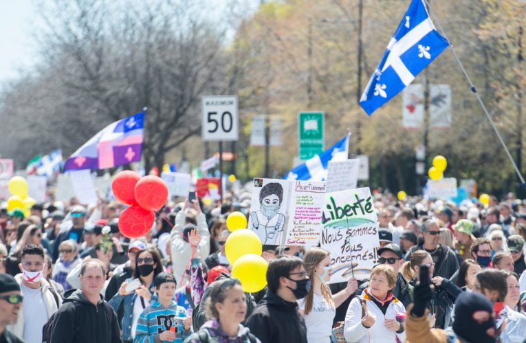 Thousands march in protest of Quebec's COVID-19 health measures