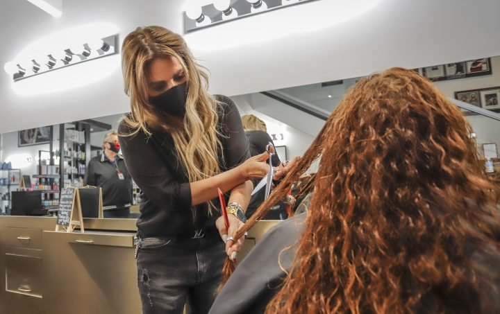 Hair salons are reopening in Canada. Did COVID-19 closures do more good than damage?